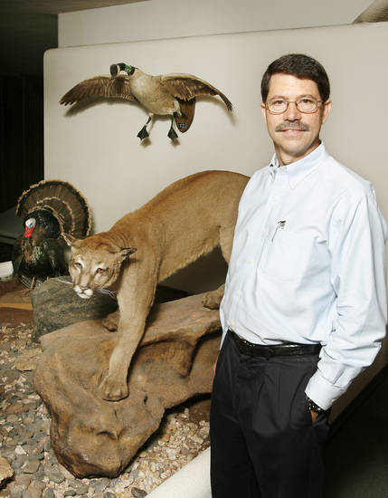 Richard Hatcher, director of the Oklahoma Department of Wildlife Conservation, standing next to the wildlife diorama outside the entrance to his office at the Oklahoma Department of Wildlife Conservation in Oklahoma City Thursday, Sept. 17, 2009. Photo by Paul B. Southerland, The Oklahoman ORG XMIT: KOD