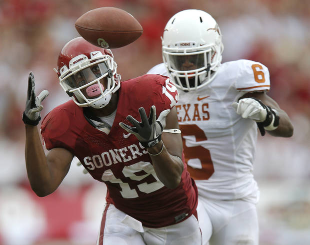 OU's Justin Brown (19) misses the catch in front of UT's Quandre Diggs (6) during the Red River Rivalry college football game between the University of Oklahoma (OU) and the University of Texas (UT) at the Cotton Bowl in Dallas, Saturday, Oct. 13, 2012. Oklahoma won 63-21. Photo by Bryan Terry, The Oklahoman