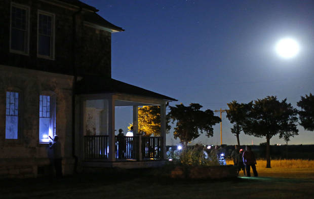 A crowd gathers around the officers' quarters during a guided ghost tour by lantern light around Fort Reno in El Reno on Saturday, Sept. 21, 2013. Photo by Bryan Terry, The Oklahoman