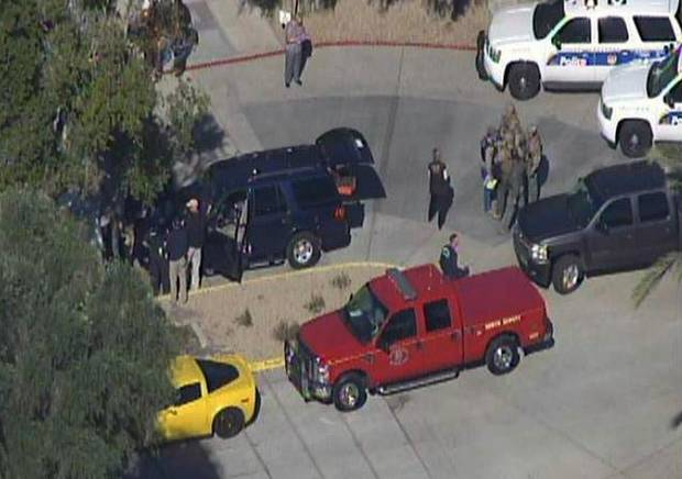 This frame grab provided by abc15.com shows the scene at a Phoenix office complex where police say someone shot at least three people on Wednesday, Jan. 30, 2013. Officer James Holmes said the victims were taken to hospitals and did not know if their injuries were life threatening. (AP Photo/abc15.com) MANDATORY CREDIT  ORG XMIT: NY117