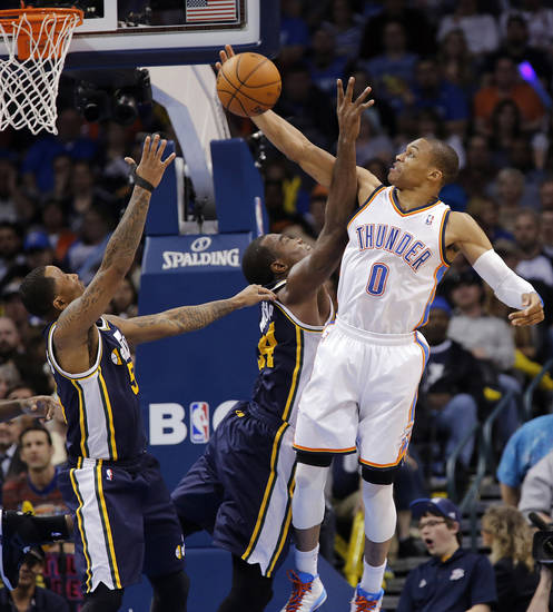 Oklahoma City Thunder&#039;s Russell Westbrook (0) is fouled by Utah Jazz&#039;s Paul Millsap (24) while battling for a rebound during the NBA basketball game between the Oklahoma City Thunder and the Utah Jazz at Chesapeake Energy Arena on Wednesday, March 13, 2013, in Oklahoma City, Okla. Photo by Chris Landsberger, The Oklahoman