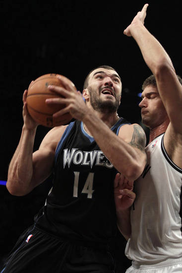 Minnesota Timberwolves' Nikola Pekovic (14) shoots over Brooklyn Nets' Brook Lopez (11) during the first half of an NBA basketball game, Monday, Nov. 5, 2012, in New York. (AP Photo/Frank Franklin II)
