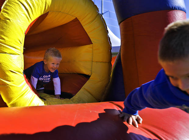 Carter Riggs, 2, chases his brother Cole though the obstacle course in the fan fest area during the Oklahoma Regatta Festival at the Oklahoma River on Saturday, Oct. 1, 2011, in Oklahoma City, Okla. Photo by Chris Landsberger, The Oklahoman