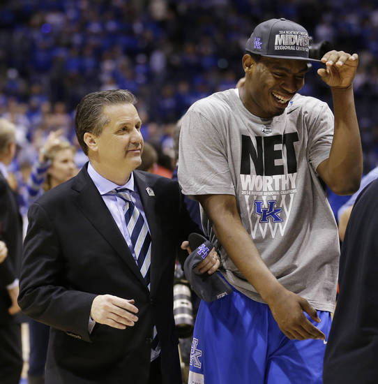 Kentucky head coach John Calipari, left, celebrates with Dakari Johnson after an NCAA Midwest Regional final college basketball tournament game Sunday, March 30, 2014, in Indianapolis. Kentucky won 75-72 to advance to the Final Four. (AP Photo/Michael Conroy)
