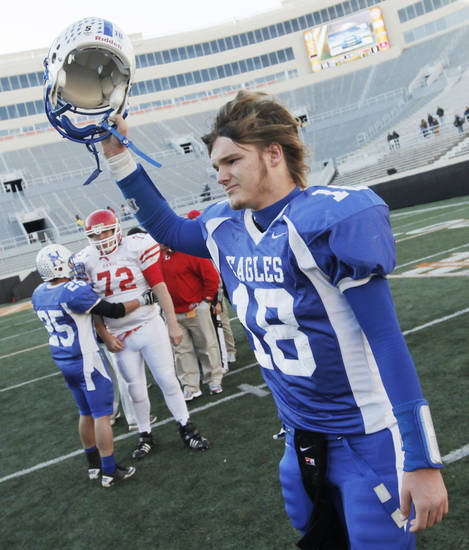 Hennessey quarterback Trey Leu (18) holds up his helmet as walks over to the Hennessey fans after the Class 2A high school football championship game between Hennessey and Davis at Boone Pickens Stadium in Stillwater, Okla., Saturday, December 11, 2010. Hennessey won, 14-0. Photo by Nate Billings, The Oklahoman