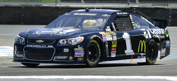 Jamie McMurray races during qualifying for the NASCAR Sprint Cup Series auto race Saturday, June 22, 2013, in Sonoma, Calif. McMyrray won the pole position for Sunday's race. (AP Photo/Ben Margot)