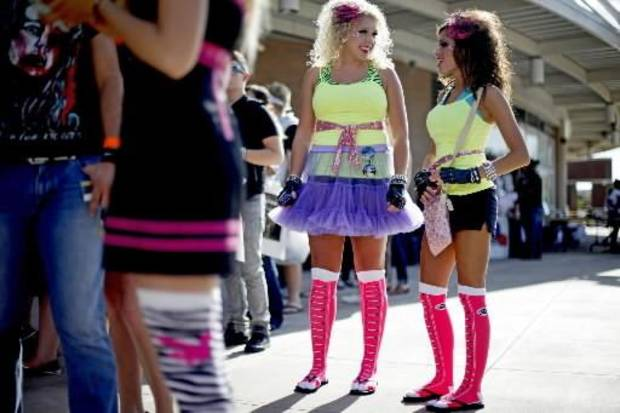 Susan Alley, left, and Elizabeth Wilson, both of Woodward, Okla., wait outside the Ford Center for the Lady  Gaga concert in Oklahoma City on Tuesday, July 20, 2010. Photo by Bryan Terry