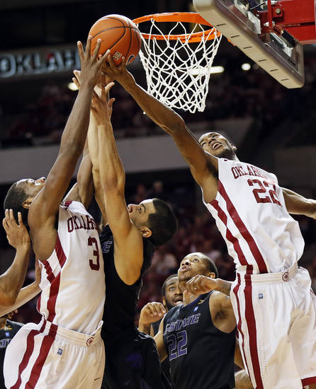 Oklahoma's Buddy Hield (3) and Amath M'Baye (22) chase a rebound against Kansas State's Angel Rodriguez (13) and Rodney McGruder (22) during an NCAA men's basketball game between the University of Oklahoma (OU) and Kansas State at the Lloyd Noble Center in Norman, Okla., Saturday, Feb. 2, 2013. Kansas State won, 52-50. Photo by Nate Billings, The Oklahoman