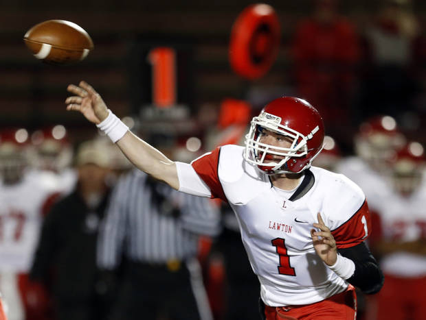 Lawton's Dallas Sealey throws the ball during the high school football game between Mustang and Lawton at Mustang High School in Mustang, Okla., Friday, Oct. 26, 2012. Photo by Sarah Phipps, The Oklahoman