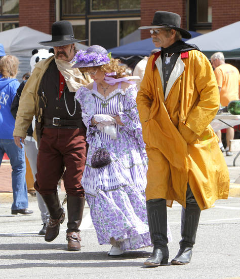 Members of the Guthrie Gunfighters walk through the streets before the beginning of the 89ers Day Parade in Guthrie, OK, Saturday, April 20, 2013,  By Paul Hellstern, The Oklahoman