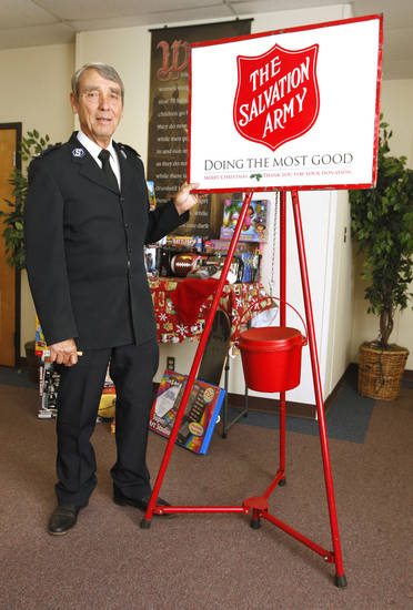 Ernie Potter, facilities manager, stands next to a Salvation Army red kettle Thursday, Oct. 25, 2012, at the Central Oklahoma Area Command for The Salvation Army in Oklahoma City. The organization?s 2012 holiday donation drive starts Nov. 9 in the metro area. Photo by Paul B. Southerland, The Oklahoman <strong>PAUL B. SOUTHERLAND - PAUL B. SOUTHERLAND</strong>