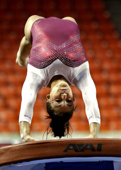 Madison Mooring makes her vault as the University of Oklahoma Sooners (OU) compete at the NCAA, Women's Gymnastics Regional at The Lloyd Noble Center on Saturday, April 6, 2013  in Norman, Okla. Photo by Steve Sisney, The Oklahoman