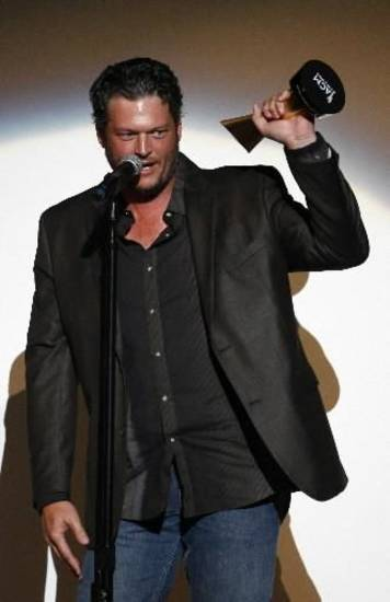 Blake Shelton accepts the Gene Weed Special Achievement Award for at the ACM Honors at the Ryman Auditorium on Tuesday, Sept. 10, 2013 in Nashville, Tenn. (AP)