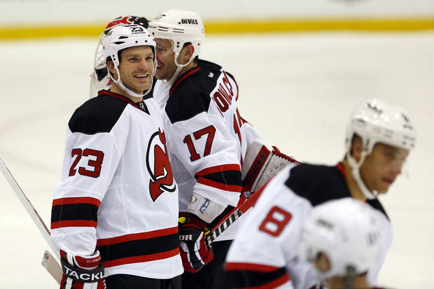 New Jersey Devils center David Clarkson (23) smiles during a scrimmage against the Albany Devils, the team's AHL farm team, Wednesday, Jan. 16, 2013, in Newark, N.J. (AP Photo/Julio Cortez)