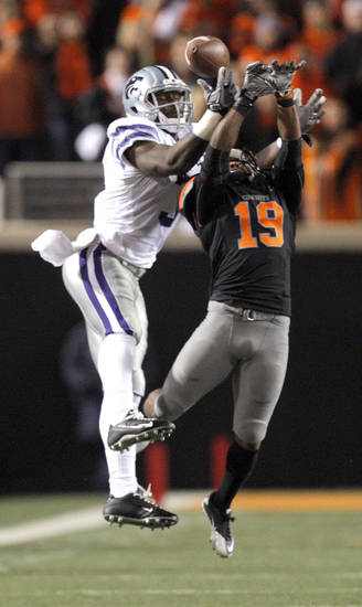 Oklahoma State's Brodrick Brown (19) tips a pass intended for Kansas State's Chris Harper (3) during a college football game between the Oklahoma State University Cowboys (OSU) and the Kansas State University Wildcats (KSU) at Boone Pickens Stadium in Stillwater, Okla., Saturday, Nov. 5, 2011.  Photo by Sarah Phipps, The Oklahoman