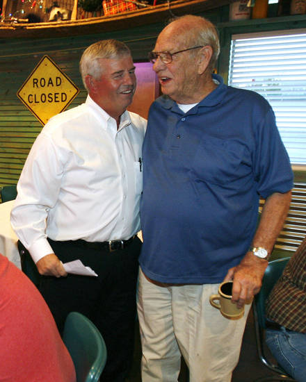 Congressional candidate Wayne Herriman (left) greets supporter Earl Everett at a watch party at Cowboy's BBQ in Muskogee, Okla. on Tuesday, August 28, 2012. MATT BARNARD/Tulsa World