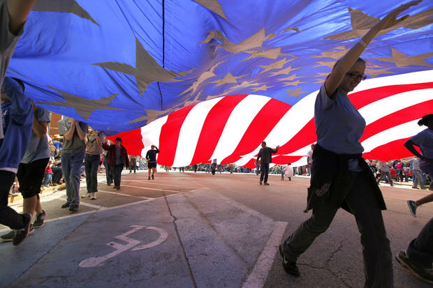 Boy Scouts carry a giant American flag in the 89ers Day Parade in Guthrie, OK, Saturday, April 20, 2013,  By Paul Hellstern, The Oklahoman