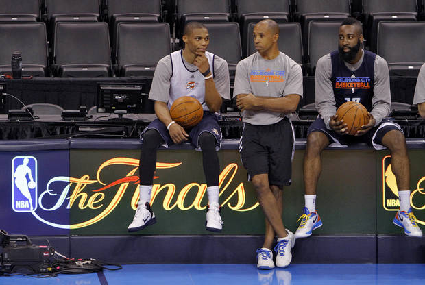 Oklahoma City's Russell Westbrook and James Harden talk with head athletic trainer Joe Sharpe during the NBA Finals practice day at the Chesapeake Energy Arena on Monday, June 11, 2012, in Oklahoma City, Okla. Photo by Chris Landsberger, The Oklahoman
