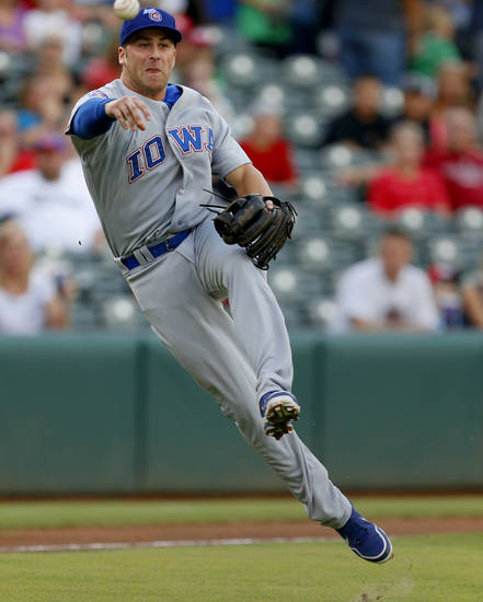 Mike Olt with the Iowa Cubs throws back to first for an out in the first inning during a baseball game against the Oklahoma City RedHawks at Chickasaw Bricktown Ballpark in Oklahoma City, Friday, July 26, 2013. Photo by Bryan Terry, The Oklahoman