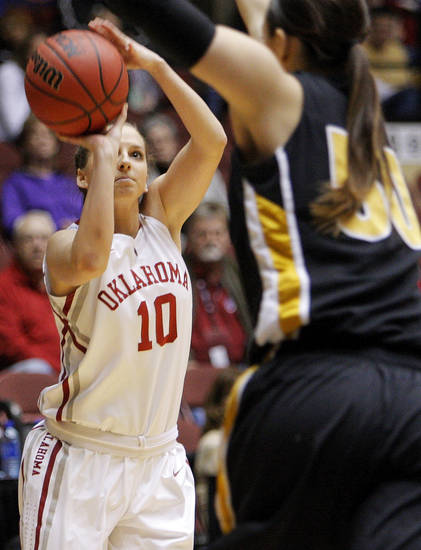 OU's Morgan Hook (10) shoots over Missouri's Christine Flores (10) during the Big 12 tournament women's college basketball game between the University of Oklahoma Sooners and the University of Missouri Tigers at Municipal Auditorium in Kansas City, Mo., Thursday, March 8, 2012. Photo by Nate Billings, The Oklahoman