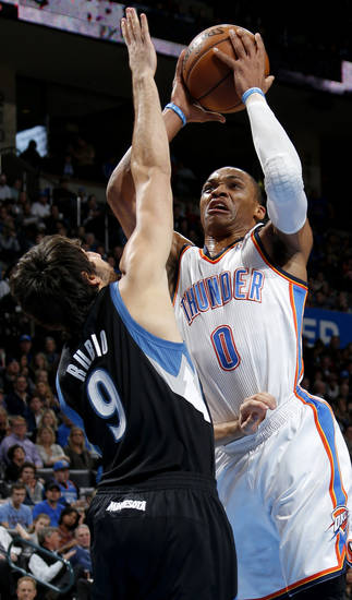 Oklahoma City's Russell Westbrook (0) goes to the basket beside Minnesota's Ricky Rubio (9) during an NBA basketball game between the Oklahoma City Thunder and the Minnesota Timberwolves at Chesapeake Energy Arena in Oklahoma City, Wednesday, Jan. 9, 2013.  Photo by Bryan Terry, The Oklahoman