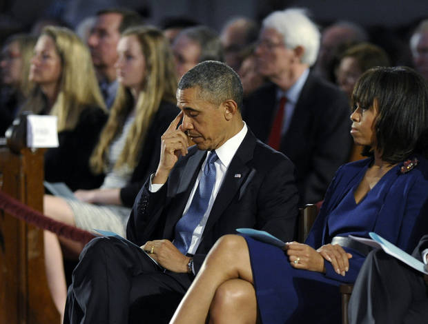 "President Barack Obama and first lady Michelle Obama attend the ""Healing Our City: An Interfaith Service"" at the Cathedral of the Holy Cross in Boston, Thursday, April 18, 2013, dedicated to those who were gravely wounded or killed in Monday�s bombing near the finish line of the Boston Marathon.(AP Photo/Susan Walsh)"