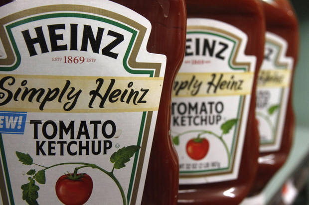 FILE - In this March 2, 2011 file photo, Heinz ketchup is seen on the shelf of a market in Barre, Vt. H.J. Heinz Co. says it agreed to be acquired by an investment consortium including billionaire investor Warren Buffett in a deal valued at $28 billion. (AP Photo/Toby Talbot, File)