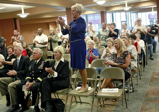 "Secretary of Military and Veterans Affairs, Gen. (Ret) Rita Aragon stands on a chair and applauds while a song is played during a ""Salute the Troops"" event at First Southern Baptist Church in Del City  on Monday, September 26, 2011. Photo by John Clanton, The Oklahoman ORG XMIT: KOD"