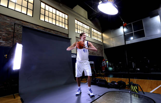 Dallas Mavericks power forward Dirk Nowitzki (41) of Germany poses for a photo during the basketball team's media day Monday, Sept. 30, 2013, in Dallas. (AP Photo/LM Otero)