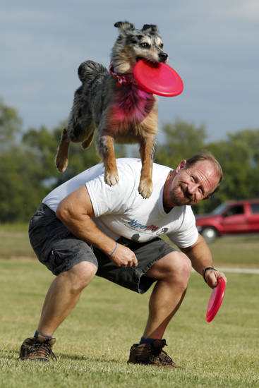 Lee Fairchild and his dog Gracie demonstrate their dog disc skills recently in Goldsby.  Photo by Steve Sisney, The Oklahoman <strong>STEVE SISNEY</strong>