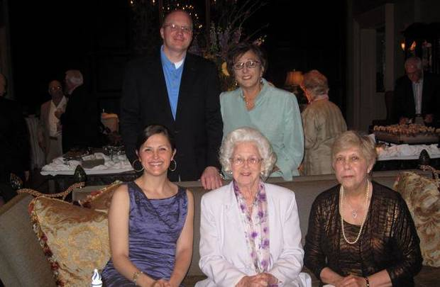 Erin Moore, Jose Freede, Maggie Barrett, seated, and Blake Beeler and Pam Shdeed, standing, have fun at the party in honor of Moore and Beeler. (Photo by Helen Ford Wallace).