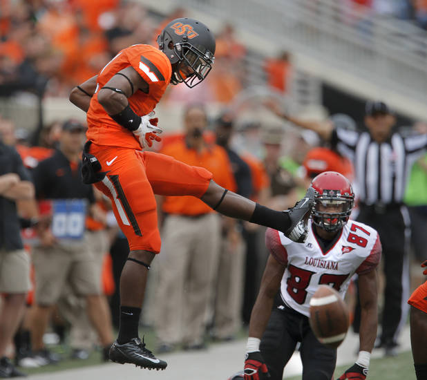 Oklahoma State's Kevin Peterson (1) celebrates a broken pass play in front of Louisiana-Lafayette's Darryl Surgent (87) during a college football game between Oklahoma State University (OSU) and the University of Louisiana-Lafayette (ULL) at Boone Pickens Stadium in Stillwater, Okla., Saturday, Sept. 15, 2012. Photo by Sarah Phipps, The Oklahoman
