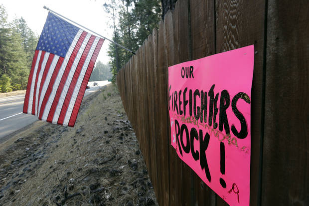 A sign thanks firefighters for their efforts near Manton, Calif., Friday, Aug.  24, 2012. Residents of the tiny mountain town of Mineral, Calif., breathed easier Friday after air tankers and helicopters blunted the run of a massive wildfire in Northern California just outside Lassen Volcanic National Park. Sixty-four homes and 20 other buildings have been destroyed, mostly in the Manton area, since lightning ignited the blaze Saturday. AP photo