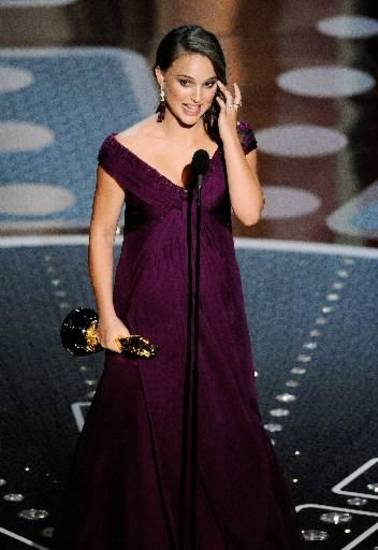 "Natalie Portman accepts the best actress award for her turn as a ballerina suffering a breakdown in ""Black Swan"" at Sunday's 83rd Annual Academy Awards. (Associated Press photos)"