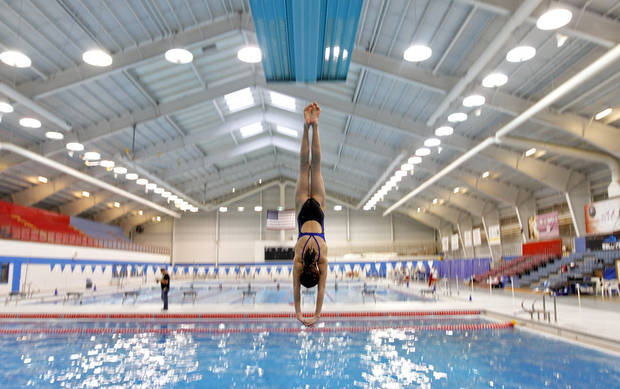 A competitor dives in from the 3m board during the 2012 Hilton HHonors Junior west national championship at Oklahoma City Community College on Friday, April 13, 2012, in Oklahoma City, Oklahoma.  Photo by Chris Landsberger, The Oklahoman