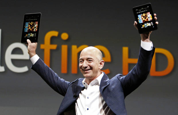 Jeff Bezos, CEO and founder of Amazon, holds the new Amazon Kindle Fire HD at the product�s introduction Thursday in Santa Monica, Calif. AP Photo