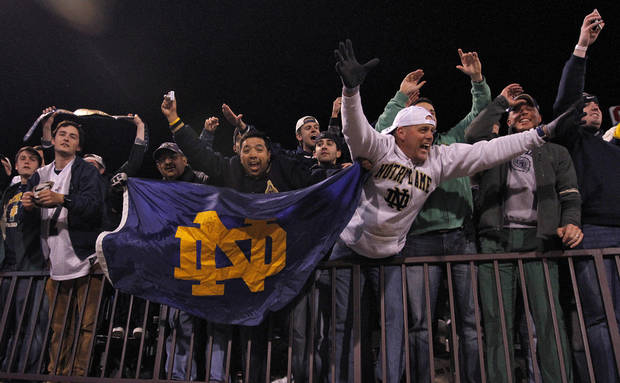 Notre Dame fans celebrate the 30-13 win over Oklahoma during the college football game between the University of Oklahoma Sooners (OU) and the Notre Dame Fighting Irish at the Gaylord Family-Oklahoma Memorial Stadium on Saturday, Oct. 27, 2012, in Norman, Okla. Photo by Chris Landsberger, The Oklahoman