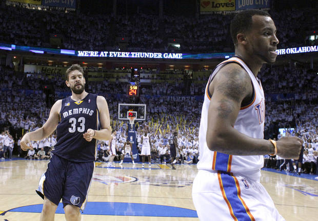 Oklahoma City&#039;s Daequan Cook (14) reacts in front of Marc Gasol (33) of Memphis after a dunk during game five of the Western Conference semifinals between the Memphis Grizzlies and the Oklahoma City Thunder in the NBA basketball playoffs at Oklahoma City Arena in Oklahoma City, Wednesday, May 11, 2011. Photo by Sarah Phipps, The Oklahoman