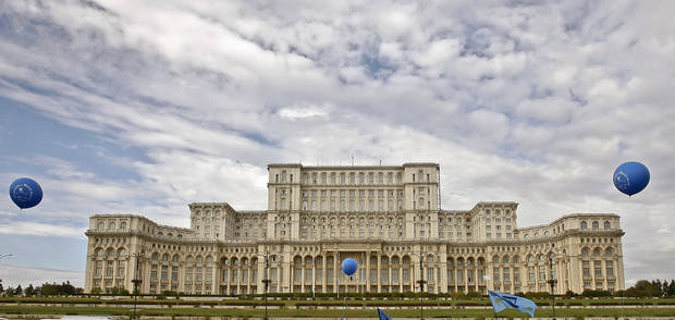 FILE - This Tuesday Oct. 7, 2008 file picture shows the Parliament Palace in Bucharest, Romania. Twenty-three years after communism collapsed, the Palace of the Parliament, a gargantuan Stalinist symbol and the most concrete legacy of ex-dictator Nicolae Ceausescu, has emerged as an unlikely pillar of Romania's nascent democracy. And while it remains one of the most controversial projects of Ceausescu's 25-year rule, albeit one that has gradually found a place in the nation's psyche, it's also now a tourist attraction, visited by tens of thousands of Romanians and foreigners every year. (AP Photo/Vadim Ghirda, File)