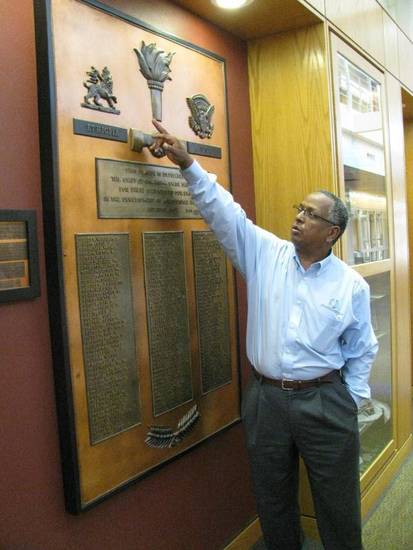 Mel Tewahade observes a display commemorating the service of Oklahoma State University faculty to Ethiopia at the Wes Watkins Center. A Point Four room was designed to honor the project. Photos provided.