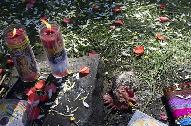 A chicken's head lays on an altar of offerings during a private ceremony at the Iximche archeological site in preparation for the Oxlajuj B'aktun in Tecpan, Guatemala Thursday, Dec. 20, 2012. The Oxlajuj B'aktun is on Dec. 21, marking a new period in the Mayan calendar, an event only comparable in recent times with the new millennium in 2000. While the Mayan calendar cycle has prompted a wave of doomsday speculation across the globe, few in the Mayan heartland believe the world will end on Friday.  (AP Photo/Moises Castillo)