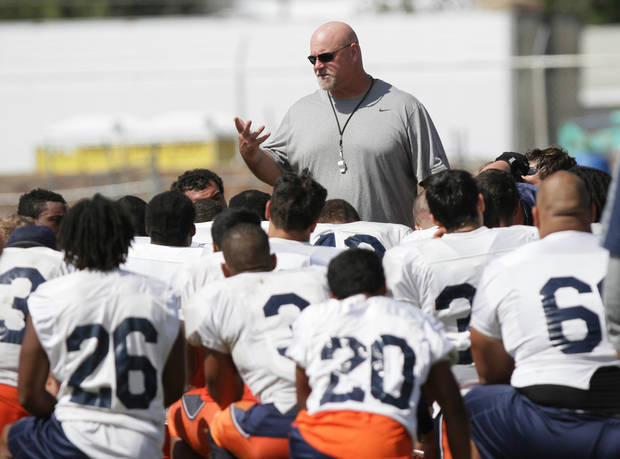 In this photo from Aug. 17, 2013, Texas El Paso head coach Sean Kugler, center, talks to his team following an NCAA college football practice in Alpine, Texas. (AP Photo/The El Paso Times, Mark Lambie) EL DIARIO OUT; JUAREZ MEXICO OUT;  EL DIARIO DE EL PASO OUT.