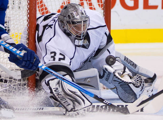Los Angeles Kings goalie Jonathan Quick makes a save on a wraparound-attempt by Vancouver Canucks' Alex Burrows during the first period of an NHL hockey game in Vancouver, British Columbia, Saturday, March 2, 2013. (AP Photo/The Canadian Press, Darryl Dyck)
