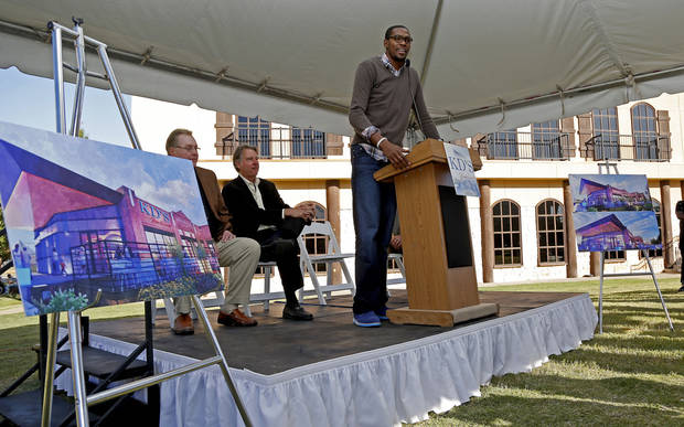 Kevin Durant speaks as Hal Smith, left, and Randy Hogan listen Tuesday during groundbreaking for Durant�s restaurant venture, KD�s, in Oklahoma City�s Bricktown district.  Photos by Bryan Terry, The Oklahoman
