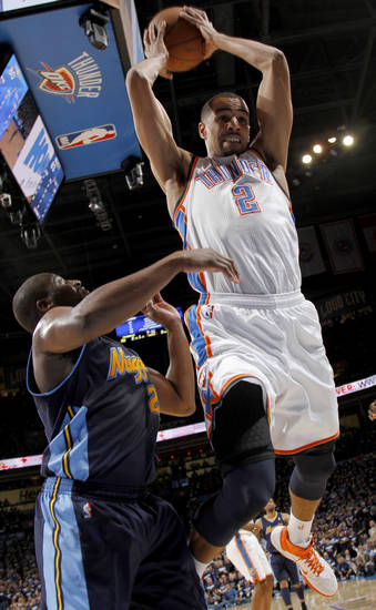 Oklahoma City's Thabo Sefolosha (2) grabs the ball beside Denver's Raymond Felton (20) during the NBA basketball game between the Denver Nuggets and the Oklahoma City Thunder in the first round of the NBA playoffs at the Oklahoma City Arena, Wednesday, April 27, 2011. Photo by Bryan Terry, The Oklahoman