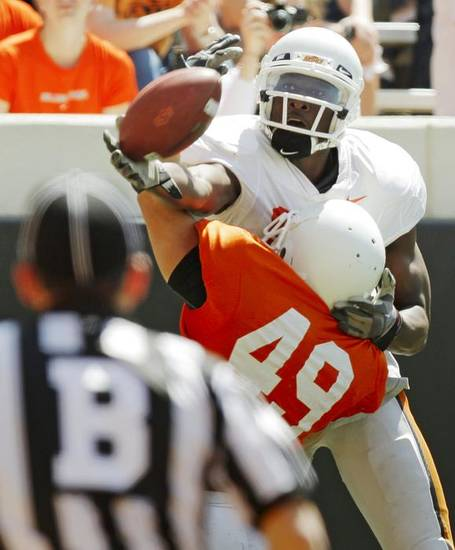 OSU's Justin Blackmon (81) misses a touchdown catch as Colby Ellis (49) defends during the Orange/White spring football game for the Oklahoma State University Cowboys at Boone Pickens Stadium in Stillwater, Okla., Saturday, April 16, 2011. Photo by Nate Billings, The Oklahoman ORG XMIT: KOD