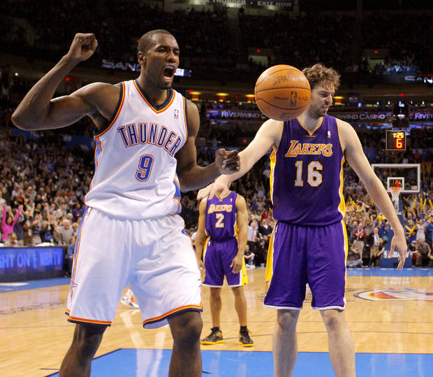 Oklahoma City's Serge Ibaka (9) celebrates next to Los Angeles' Pau Gasol (16) during an NBA basketball game between the Oklahoma City Thunder and the Los Angeles Lakers at Chesapeake Energy Arena in Oklahoma City, Thursday, Feb. 23, 2012.  Oklahoma City won 100-85. Photo by Bryan Terry, The Oklahoman