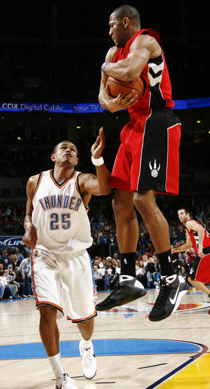 Toronto's Joey Graham grabs a rebound over Earl Watson of Oklahoma City in the second half of the NBA basketball game between the Toronto Raptors and the Oklahoma City Thunder at the Ford Center in Oklahoma City, Friday, Dec. 19, 2008. The Thunder won, 91-83. BY NATE BILLINGS, THE OKLAHOMAN