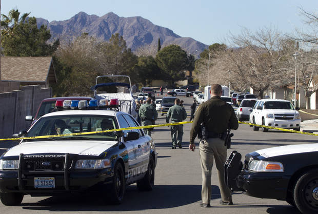 Law enforcement officials investigate a shooting and fire in Boulder City, Nev., Monday, Jan. 21, 2013. Las Vegas police spokeswoman Carla Alston confirmed that a Las Vegas police officer was involved in the 9 a.m. Monday incident. She says Henderson police are handling the investigation. (AP Photo/Las Vegas Sun, Steve Marcus)