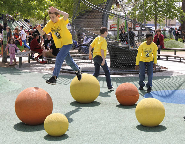 Children play in the kid's area during the Festival of the Arts in downtown Oklahoma City, OK, Thursday, April 25, 2013,  By Paul Hellstern, The Oklahoman